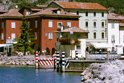 Torbole: renowned center for windsurfing and sailing of lake Garda. Tourist information about apartments, camping and hotels for your holidays to lake Garda, Italy.